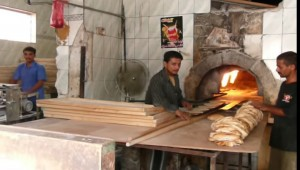 "Bread loaves the ""size and weight of a pen"" are symbols of Yemen's currency crisis"