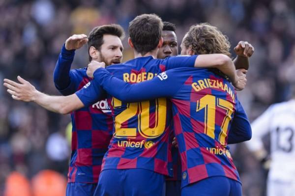 Barca beats Getafe to keep pressure on Real