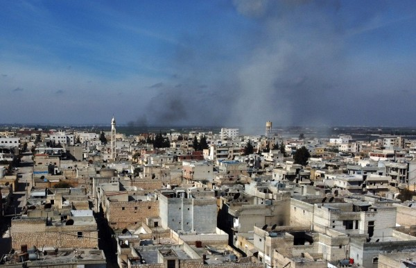 Syrian government forces reenter strategic town, Turkey vows to keep up strikes