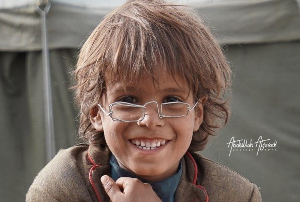 Displaced child's 'glasses' auctioned for $4200, enough to buy Eid clothes for all the kids in his IDP camp