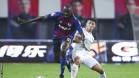 Yaya Toure: Ex-Manchester City midfielder helps Qingdao Huanghai to promotion